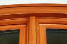 Maintaining these finely crafted arched wooden windows