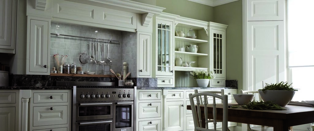 Newly painted kitchen cabinets update a kitchen on a budget