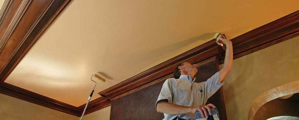 Interior painting specialists painting a ceiling