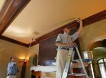 Protecting the ceiling's trim and special features before applying the paint