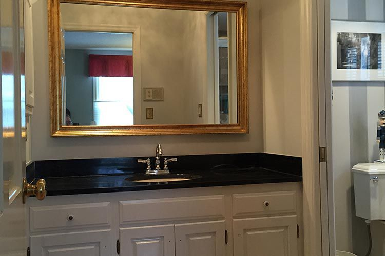 Renovating master bath includes painting bathroom cabinets